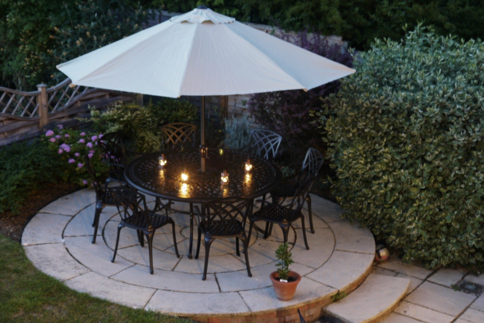 Lazy Susan's Olivia Garden Table looking beautiful with candle light